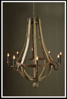 French Aged Wood Strap and Iron Chandelier with Rounded Bottom Electrified with Eight Lights and Ball Decor Canopy and Chain Not Included Sizes Vary Slightly Please call for exact Measurements As Seen In House Beautiful November 2007