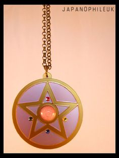 """Sailor Moon Crystal Star Necklace with mirror - Cut to order and Customisable. Laser cut acrylic, Swarovski crystals & Rose Quartz by JapanophileUK, $24.39     The outside rim and star are crafted out of a rich gold colour acrylic. The rest of the pendent is a dusky baby pink. Up to 12 letters can be engraved onto the mirror to personalise it. The piece is adorned with four individual, certified Swarovski crystals and the central gem is a 10mm Rose Quartz. """"Moon Crystal Power Make Up!"""""""
