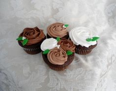 Chocolate Cheesecake Cupcakes - Triple chocolate cake filled with cheesecake filling and topped with milk chocolate, chocolate and whipped cream buttercream roses and sugar pearls.