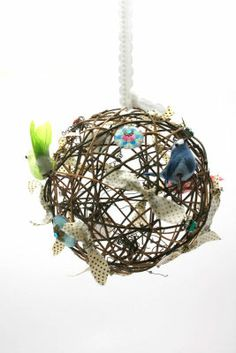 An idea for real bird nesting scraps: could be hung outside & filled with yarn scraps  to help feathered friends.
