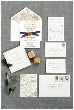 Wedding invitation suite and save the date with gold and gray accents, wax seal and ribbon details. Wedding invitation and program by Reaves Engraving, save the date and map by Plainjane Designs, calligraphy by Lydia Whitener. Velvet ring box by The Mrs. Box, ring from Solomon Brothers. Image by Rustic White Photography.