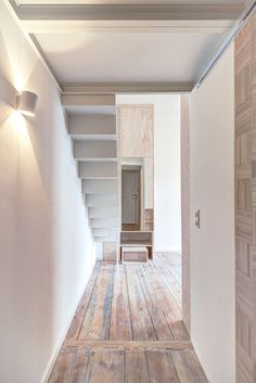 Pale wooden unit frames rooms and creates a new floor inside a Berlin micro-apartment.