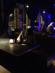 I loved the composition and light here. Sleeping drunk man in a bar