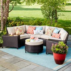 Sink into comfy contentment on the cushions of this Threshold Harrison, 7-Piece Wicker Sectional Patio Seating Set. A sturdy, powder-coated steel frame supports finely-woven wicker seating and polyester-filled cushions for a bold statement in outdoor furniture. Patio furniture set includes 4 patio armless chairs, 2 accent tables, 1 patio ottoman and coordinating back pillows and cushions. Wonderful on its own or combined with other pieces to meet your seating needs. The included ottoman…