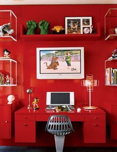 Modern Children's Room by Robert Passal in New York, New York.  Cabinet is painted in Porsche red car paint