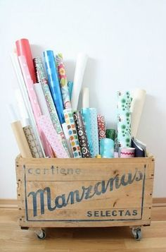 wrapping paper storage in wooden crate with wheels, or even chairs in a garage ! Wooden Crates On Wheels, Old Crates, Wooden Boxes, Kids Bathroom Storage, Wrapping Paper Storage, Collapsible Storage Bins, Ideas Para Organizar, Workspace Inspiration, Hobby Room