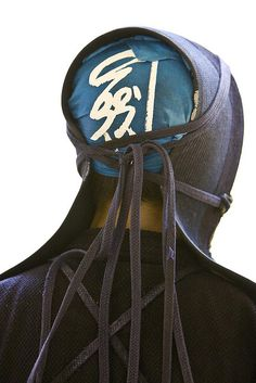 Backside shot of one of the kendo players ready for his fight. His head scarf says 剣 sword. You can see the ropes used to tie his helmet on. Kendo, Nihon, Katana, Ropes, Japan Travel, Martial Arts, Sword, Samurai, Helmet