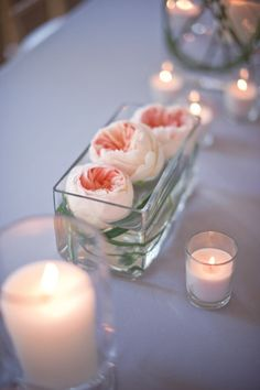 organically grown flowers and organic coconut wax candles in reclaimed glass vases