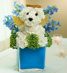 Its a dog flower arrangement. I'm not pinning this for the obvious reason it was made. I think it would be cute to have for no reason at all.