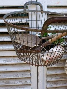 vintage wire basket great for keeping gardening tools handy when you need them