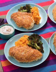 With seasonal sides of crispy roasted broccoli and mashed sweet potatoes, this crunchy parmesan chicken dish is an instant family favorite.