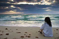 Sitting alone by the ocean....