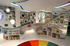 Another bookstore on my travel itinerary: Poplar Kid's Republic in Beijing, China. Adults can fit in those round lit booths!