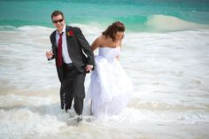 Bride and groom having some fun in the water. Taken during a destination wedding in Barbados.