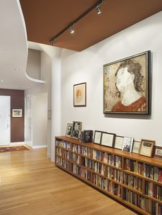 Very sleek. Books below, photos on top shelf, statement art piece on wall above.