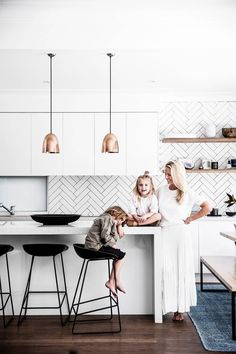 "A monochrome coastal kitchen: With the ability to pull a room together as effortlessly as an outfit, studying interiors was a natural next step for Kristin. She describes her aesthetic as ""laidback, clean and as minimal as you can be with two babes and a puppy"" 
