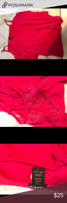 Torrid hot pink shirt A torrid hot pink shirt with cute designs on shoulders as pictured. Can be dressed up or down. Worn only once! torrid Tops
