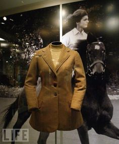 A riding jacket worn by Jacqueline Kennedy is displayed at the  Jacqueline Kennedy exhibit November 12, 2004 at the Field Museum in  Chicago, Illinois.