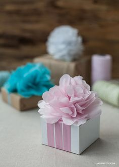 Make Some Mini Tissue Poms and Flower Gift Toppers... these are so cute and easy..... she did a nice job!!!