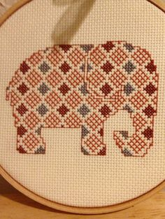 This is a beautiful handmade cross stitch of an elephant. A cute quirky item perfect for any animal lover or lover of cute crafts! Colors can