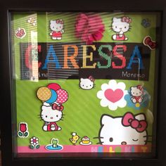 Hello Kitty cross stitched name in a shadow box.