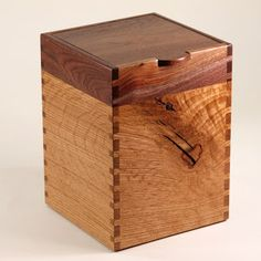 Recycled Black Walnut and Quarter-Sawn White Oak Box using recycled wood and cut to showcase a large dramatic knot in the front.