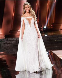 Miss USA 2015 Olivia Jordan in a Berta gown with cape at the Miss Universe 2015 show