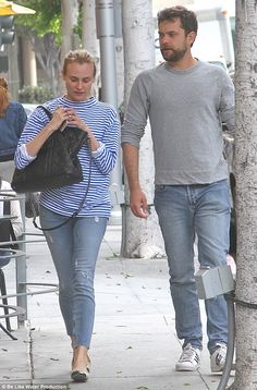 Back to basics:Fresh-faced Diane Kruger cut a casually chic figure in a Breton top and sk...