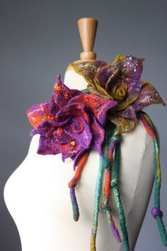 """The scarf consists two hand felted cords ( 56"""" ) and a large ( approx. 8"""" in diameter ) flower. The flower is attached to the cords"""