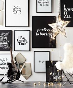 A wall of black-and-white quote art makes a bold—and personal—statement.
