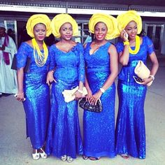 Fabulously Gorgeous Aso-Ebi Styles | Nigerian wedding styles. Yellow Gele. Blue top and Blue Skirt. Nigerian aso ebi styles.