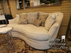 A.R.T. kidney shaped single cushion sofa in cream with brass nailhead accents. Elegant curves making is classy but comfortable casual. Measures 89*45*39.