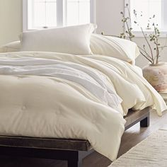 Bamboo/Cotton Comforter - An inviting year-round layer, our comforter is crafted from a blend of 70% bamboo rayon and 30% cotton. Why do we love this combination? It's durable, breathable, hypoallergenic and divinely soft to the touch.
