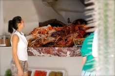 #nammos #Mykonos #Greece #beach #cuisine #seafood #lobster #greekislands #greeksummer #greeklife #vips #luxurylife #bikini #coutureoverdose #fun Waitress admiring the fresh seafood offered for fine-dining at Nammos Restaurant by the Sea Beach Club http://redvelvetvoyage.com/2014/08/09/nammos-gluttonous-by-the-sea-mykonos-psarou-beach