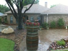 Small water feature using whiskey barrels & wine bottles!