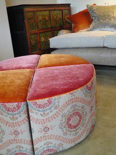 Upholstered segmented ottoman footstool