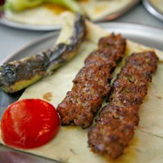Spiced Lamb Kebabs Recipe - Wide, flat metal skewers are ideal for grilling this style of ground-meat kebab. The spiced meat mixture can also be formed into patties if you don't have skewers.