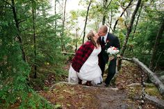 The Tessiers stop for a kiss overlooking their scenic view, which was expertly selected by the groom! He also chose the buffalo plaid details.