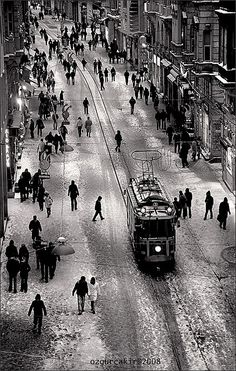 "Istiklal Street, Beyoglu, ancient Pera district . Beyoglu is derived from both ""Bey-Oglu"", Son of Bey, and ""Bailo"", the Venetian Ambassador who lived in a grand Palace in Pera . Also Pera means ""across"" in Greek, as in Across the Golden Horn from Byzantium, and yes, the Byzantines were Greeks. And lo and behold, the tramways still run, and yes it does snow on occasion in Isty. When it does, it is a hell of a fun slip-sliding town."
