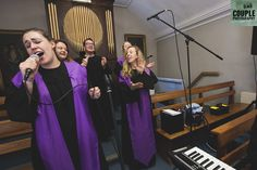 The gospel choir sing during the wedding ceremony. Weddings at Druids Glen Hotel by Couple Photography.