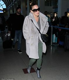 Absolute perfection!The 51-year-old jetted to the West Coast rocking the heavy cover up, ...