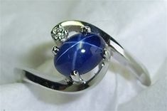 Women's Star Sapphire Ring  I had a ring like this... It was beautiful but didn't want to keep something that would bring bad memories :(