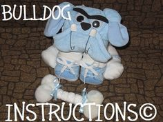 Instructions to make this adorable Diaper Dog centerpiece. GR8 for baby shower gift diaper cake topper keepsake. $8.99, via Etsy.