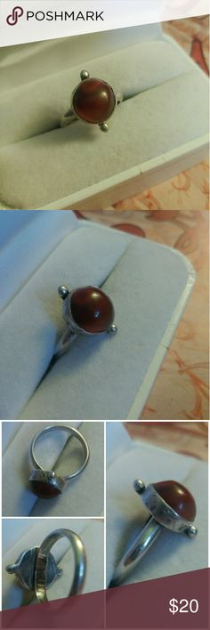 Sterling silver bohemian red stone ring Sterling silver bohemian red stone ring  -This ring features a red stone that has brown tones I am unsure of what the stone is exactly  - this ring is Bali boho style, is unmarked but is 100% guaranteed sterling silver  -This ring is an older used ring and shows signs of wear such as scratches dings and tarnish no damage to the gem please look over the pictures carefully  -boho, Bali, hippie, gypsy, fortune teller, free people like, urban outfitters…