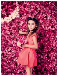 A gorgeous floral walled back drop features for Baby Dior's spring/summer 14 campaign. Subscribers click here for our Spring Bloom girls' occasionwear capsule.