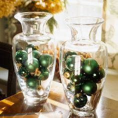 Simple green ornaments displayed in clear glass vases shine with a touch of the Irish. The arrangements work great for a centerpiece or tabletop decoration.