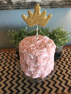 Pink and gold 1 year old birthday cake, and crown cookie.