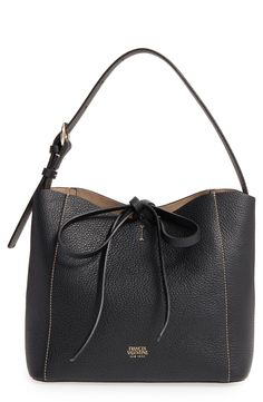 A sized-down hobo bag made from richly textured leather serves as a polished and versatile style essential.