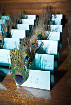 Peacock escort cards from a Chic Productions Wedding.