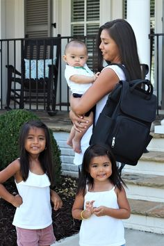 Vegan leather diaper bag backpack that is great for multiple children.  Spacious diaper bag that is waterproof,  has 10 organized pockets and comes with a shoulder strap and changing pad.